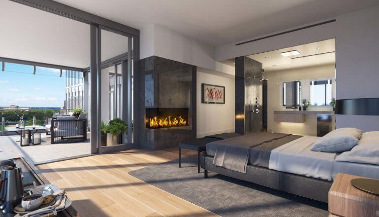 large master bedroom with fireplace in luxury condo in Philadelphia
