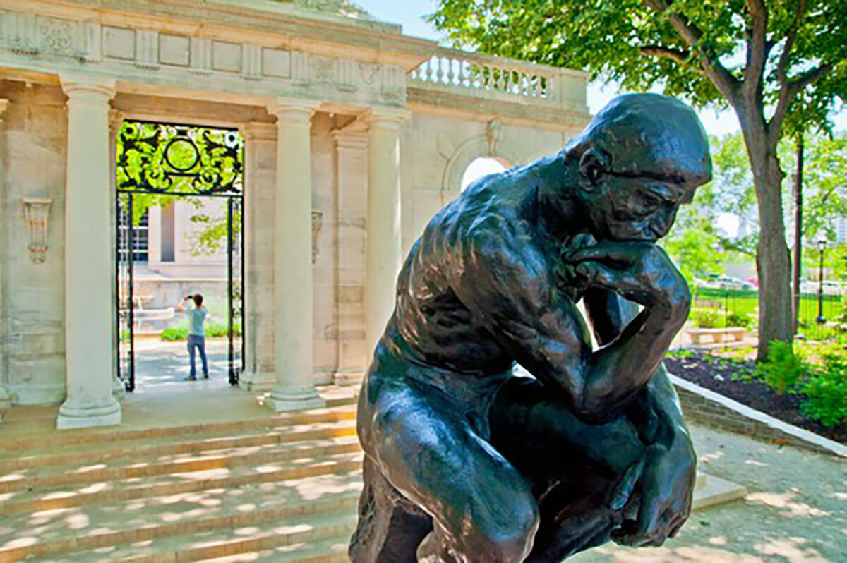 Rodin's The Thinker statue on the parkway in Philadelphia near luxury high rise condos